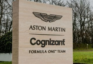 2021 Aston Martin Cognizant F1 Team logo in front of the factory Photo Formula1-com