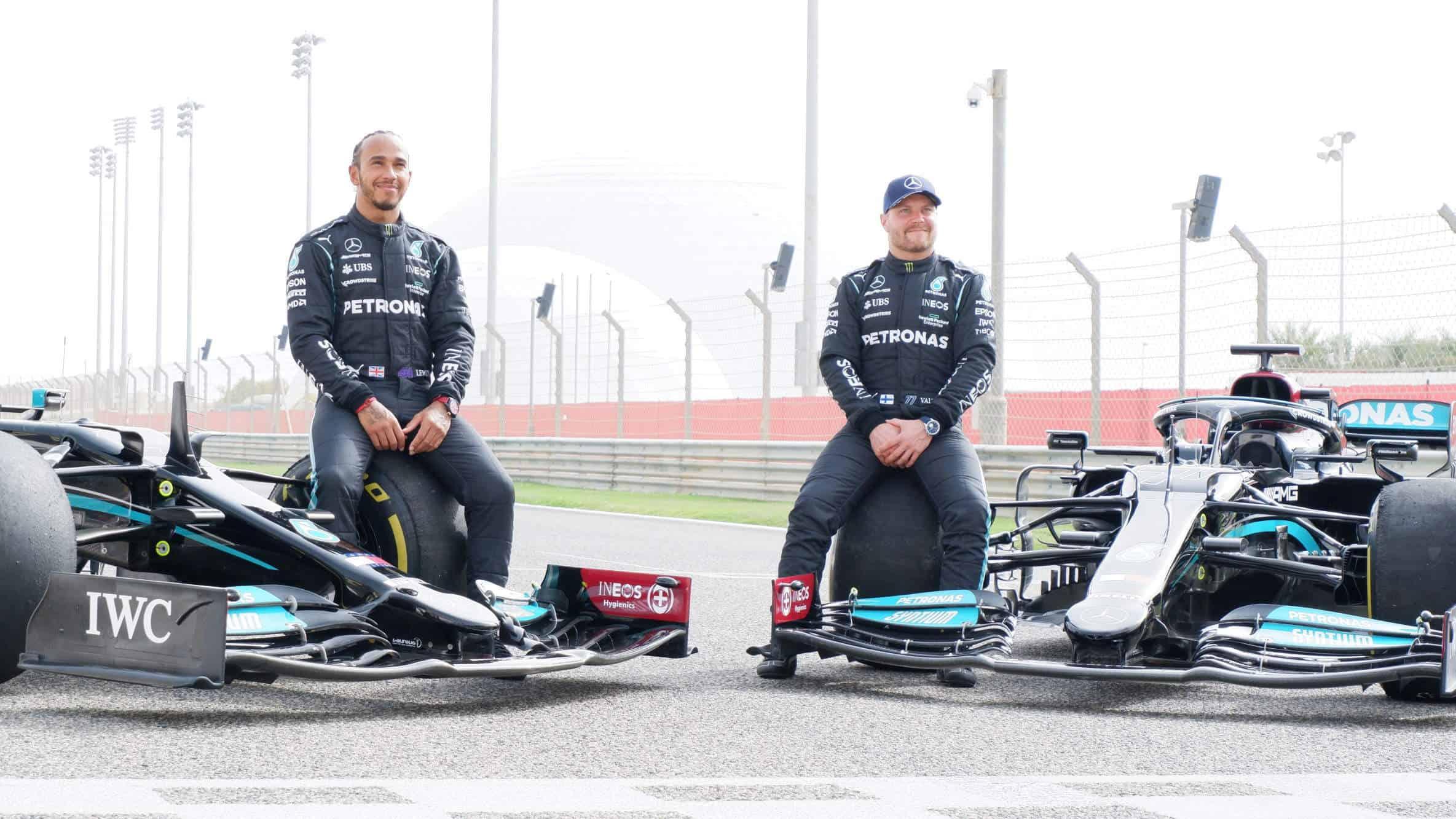 2021 Bahrain F1 Mercedes private test filming day Hamilton Bottas pose with their cars Photo Daimler