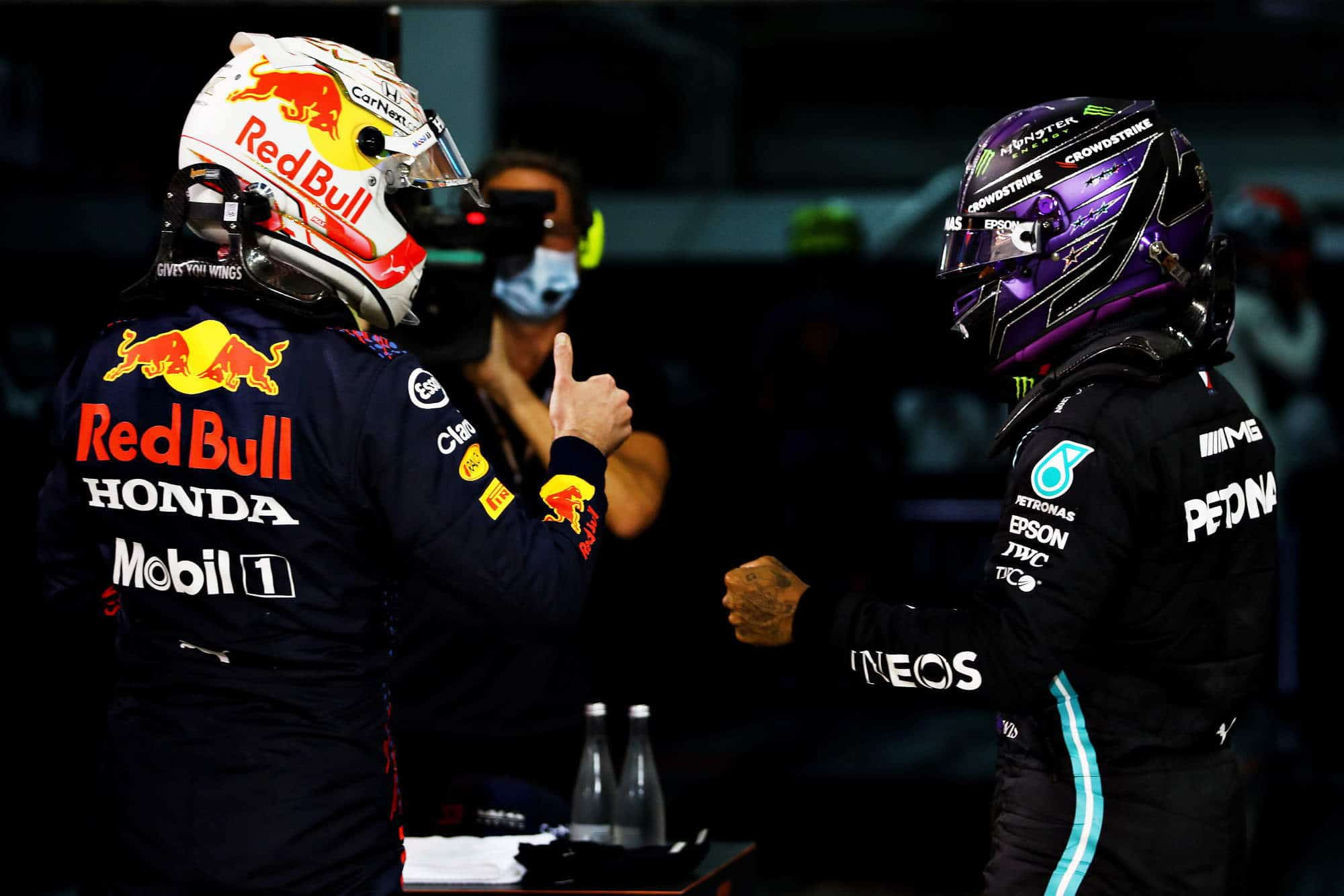 2021 Bahrain GP Hamilton Mercedes Verstappen Red Bull after the race out of ther cars Photo Red Bull
