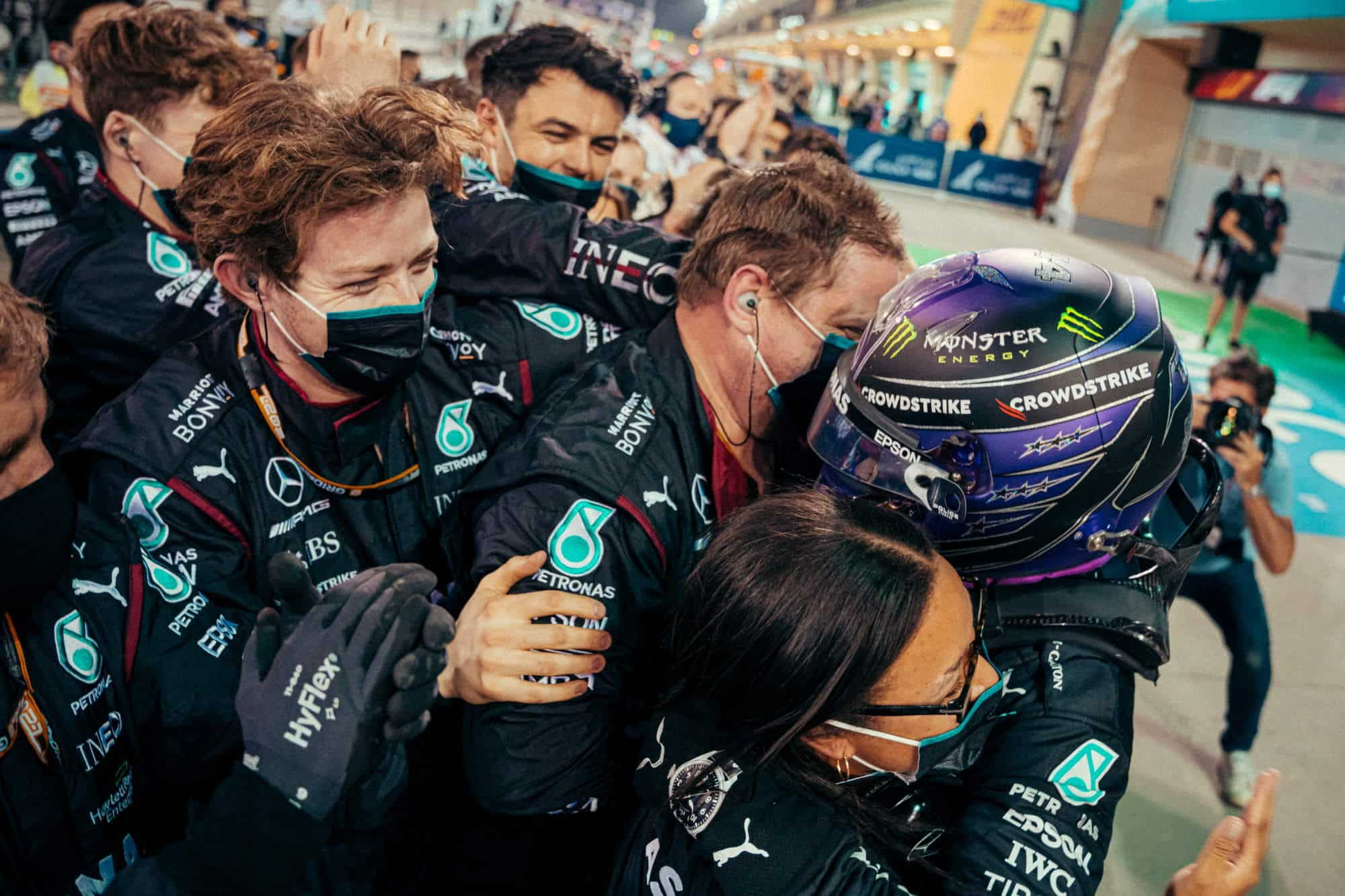 2021 Bahrain GP Hamilton Mercedes after the race out of the car with his team Photo Daimler