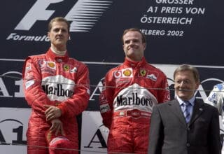 2002 Austrian GP Schumacher Barrichello podium Photo Ferrari Edited by MAXF1net