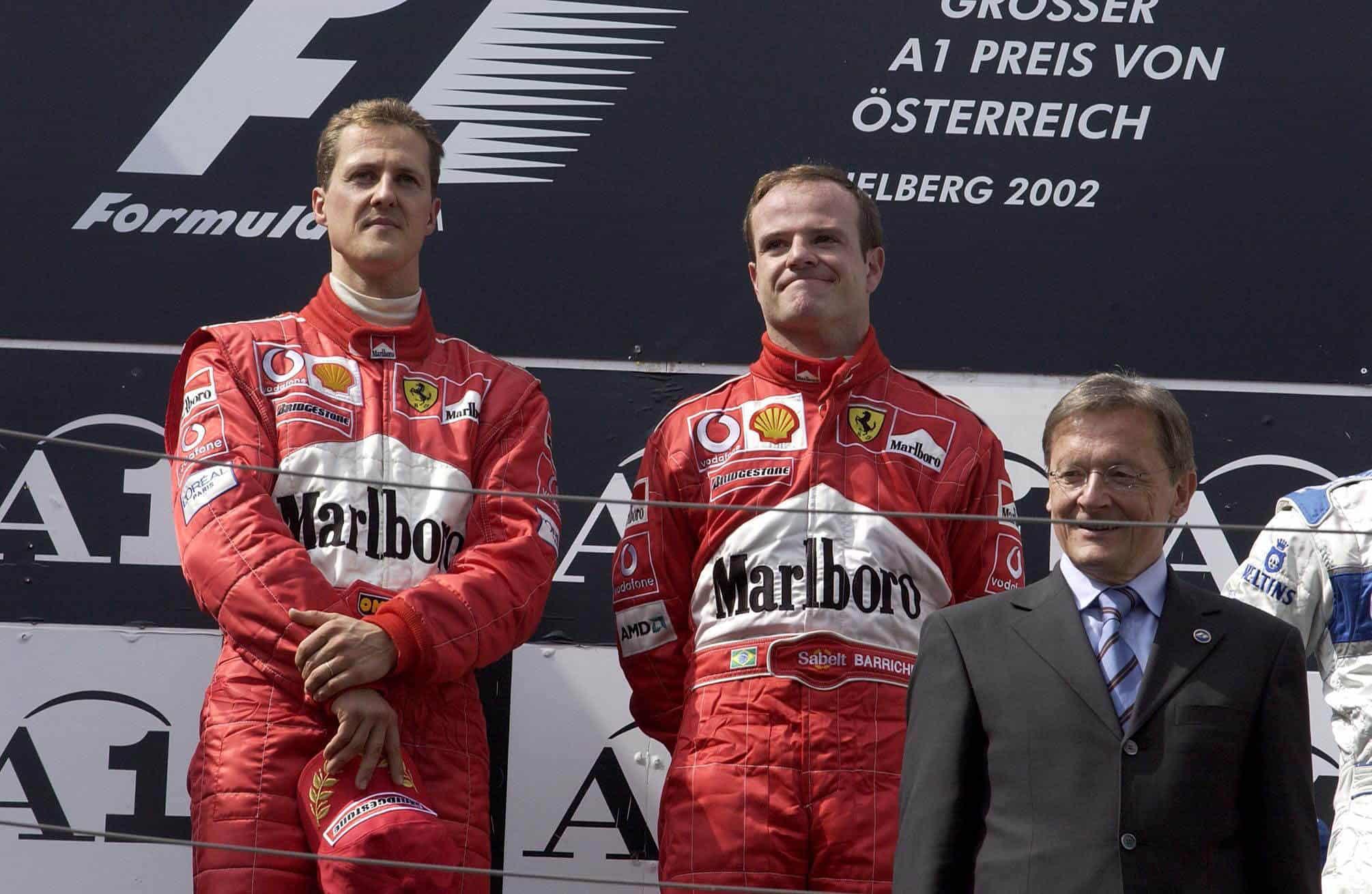 2002 Austrian GP Schumacher Barrichello podium Photo Ferrari Edited by MAXF1net