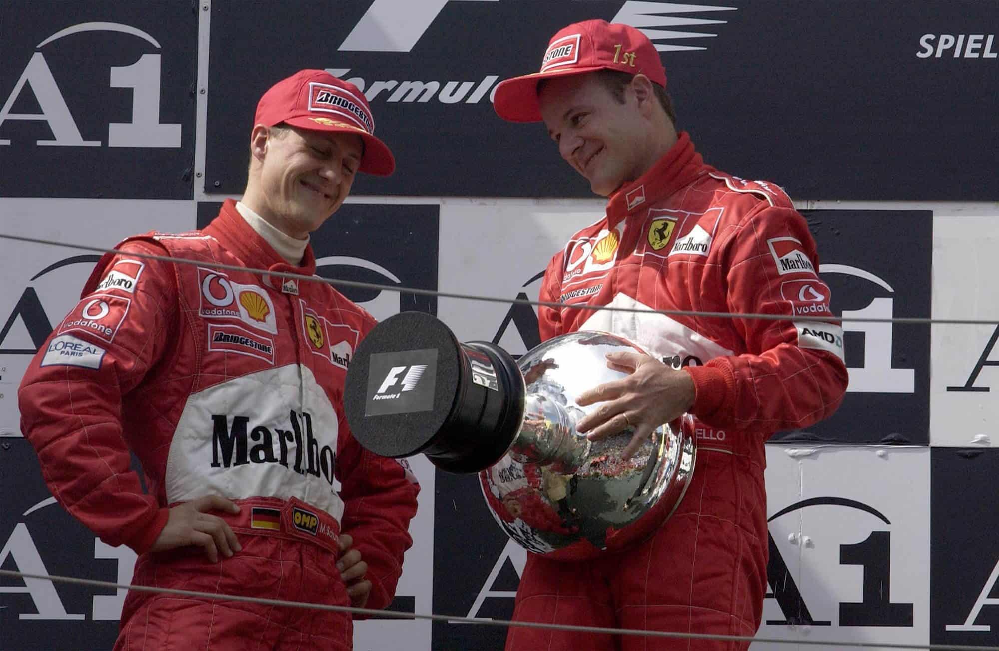 2002 Austrian GP Schumacher Barrichello podium with trophy Photo Ferrari Edited by MAXF1net
