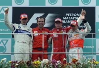 2008 Malaysian GP Raikkonen Kubica Kovalainen on the podium zoom Photo Ferrari