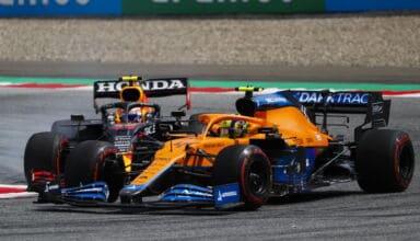 Lando Norris, McLaren MCL35M, leads Sergio Perez, Red Bull Racing RB16B